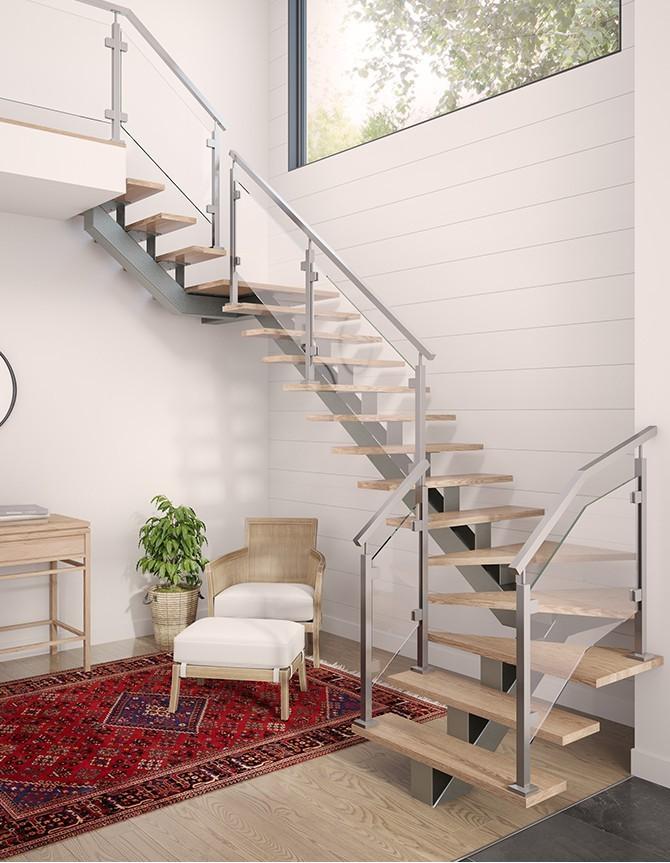 Escalier avec garde-corps en verre et poteaux en acier inoxydable